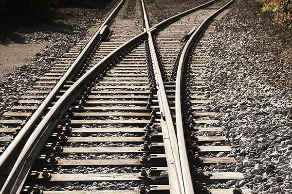 Photo of divergent railroad tracks.